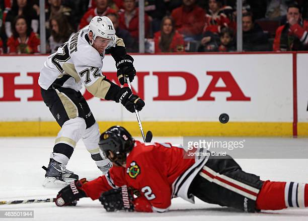 Patric Hornqvist of the Pittsburgh Penguins shoots over Duncan Keith of the Chicago Blackhawks at the United Center on February 15 2015 in Chicago...