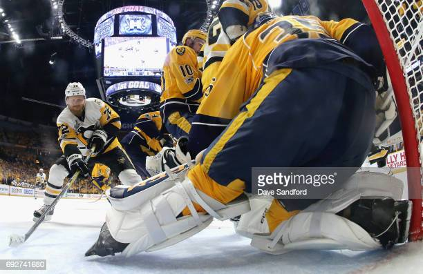 Patric Hornqvist of the Pittsburgh Penguins takes a shot on goaltender Pekka Rinne of the Nashville Predators during the first period of Game Four of...
