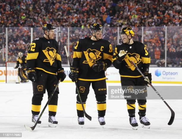 Patric Hornqvist Sidney Crosby and Jake Guentzel of the Pittsburgh Penguins skate against the Philadelphia Flyers during the 2019 Coors Light NHL...