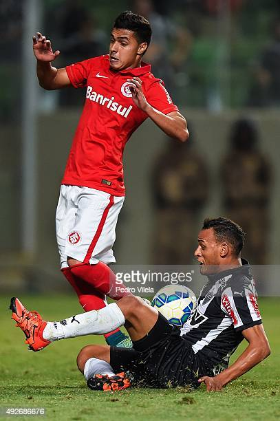 Patric of Atletico MG and Alisson Farias of Internacional battle for the ball during a match between Atletico MG and Internacional as part of...