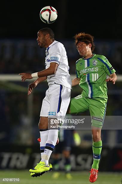 Patric of Gamba Osaka and Daisuke Kikuchi of Shonan Bellmare compete for the ball during the J.League match between Shonan Bellmare and Gamba Osaka...