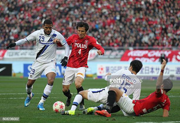 Patric of Gamba Osaka and Daisuke Nasu of Urawa Red Diamonds compete for the ball during the 95th Emperor's Cup final between Urawa Red Diamonds and...