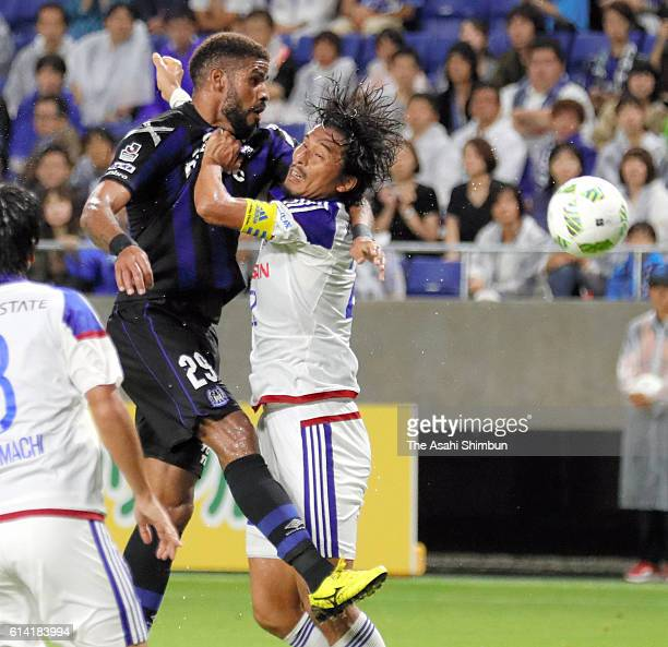 Patric of Gamba Osaka and Yuji Nakazawa of Yokohama FMarinos compete during the JLeague Levain Cup semi final first leg match between Gamba Osaka and...
