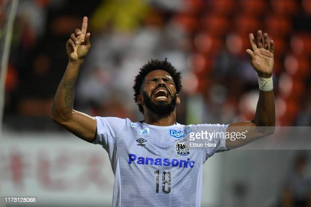 Patric of Gamba Osaka celebrates after scoring his side's first goal during the J.League Levain Cup quarter final second leg match between FC Tokyo...