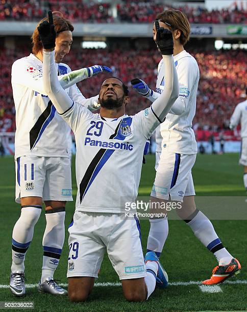 Patric of Gamba Osaka celebrates scoring his team's second goal with his team mates during the 95th Emperor's Cup final between Urawa Red Diamonds...