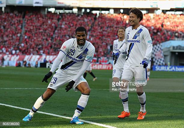 Patric of Gamba Osaka celebrates scoring his team's second goal with his team mate Kim Jungya during the 95th Emperor's Cup final between Urawa Red...