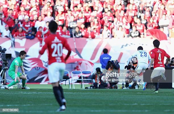 Patric of Gamba Osaka scores his team's first goal during the 95th Emperor's Cup final between Urawa Red Diamonds and Gamba Osaka at Ajinomoto...