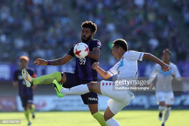 Patric of Sanfrecce Hiroshima and Akito Fukumori of Consadole Sapporo compete for the ball during the JLeague J1 match between Sanfrecce Hiroshima...