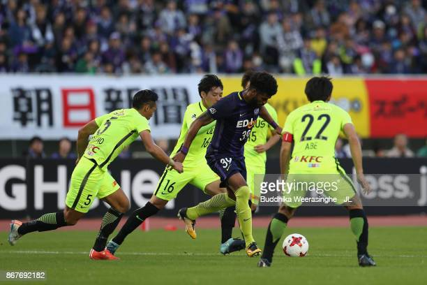 Patric of Sanfrecce Hiroshima controls the ball under pressure of Urawa Red Diamonds defense during the JLeague J1 match between Sanfrecce Hiroshima...