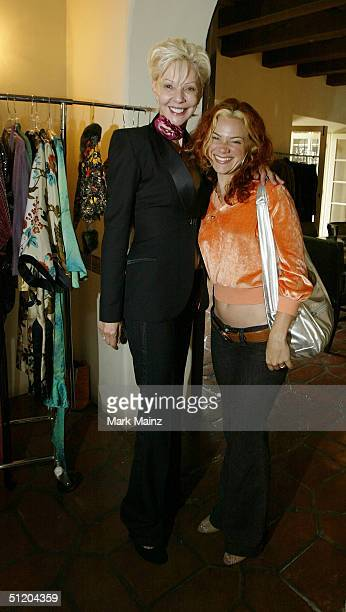 Patric Reeves and musician Nikka Costa attend the Nina Morris Trunk Show at Patric Reeves' home August 21 2004 in Los Feliz California