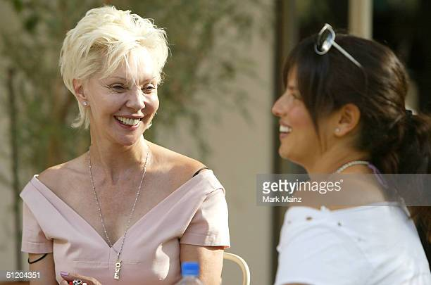Patric Reeves and musician Noa Tisby attend the Nina Morris Trunk Show at Patric Reeves' home August 21 2004 in Los Feliz California