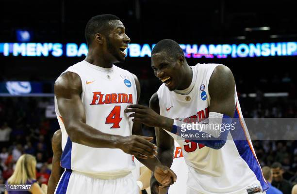Patric Young and Vernon Macklin of the Florida Gators celebrate durig their 83 to 74 win over the Brigham Young Cougars during the Southeast regional...