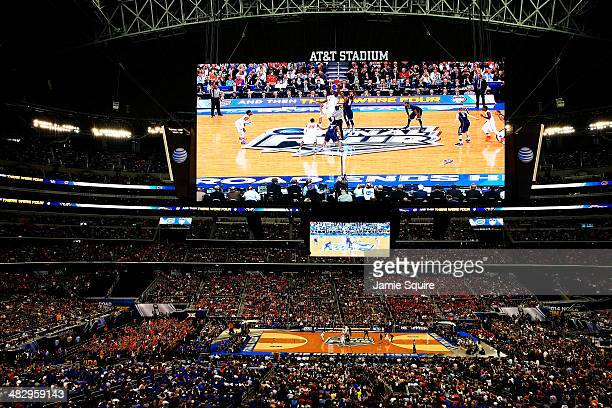 Patric Young of the Florida Gators and Phillip Nolan of the Connecticut Huskies jump for the opening tip of the NCAA Men's Final Four Semifinal at...
