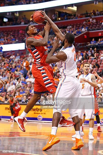 Patric Young of the Florida Gators blocks the shot by Alex Davis of the Fresno State Bulldogs during the MetroPCS Orange Bowl Basketball Classic on...
