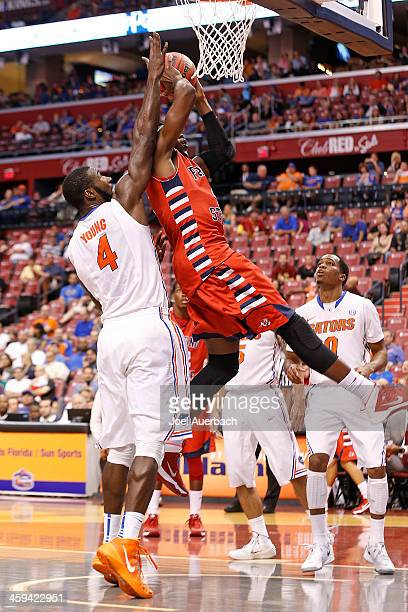 Patric Young of the Florida Gators blocks the shot by Karachi Edo of the Fresno State Bulldogs during the MetroPCS Orange Bowl Basketball Classic on...