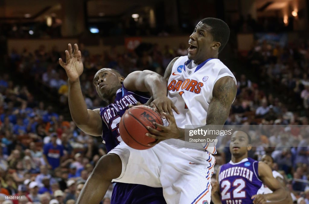 Patric Young #4 of the Florida Gators crashes into Gary Roberson #34 of the Northwestern State Demons during the second round of the 2013 NCAA Men's Basketball Tournament at The Frank Erwin Center on March 22, 2013 in Austin, Texas.