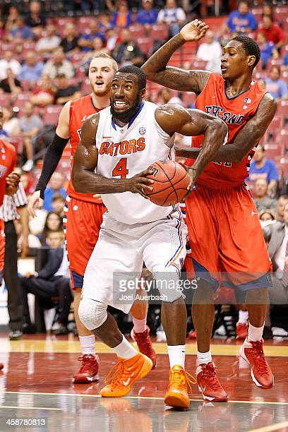 Patric Young of the Florida Gators dribbles to the basket past Alex Davis of the Fresno State Bulldogs during the MetroPCS Orange Bowl Basketball...