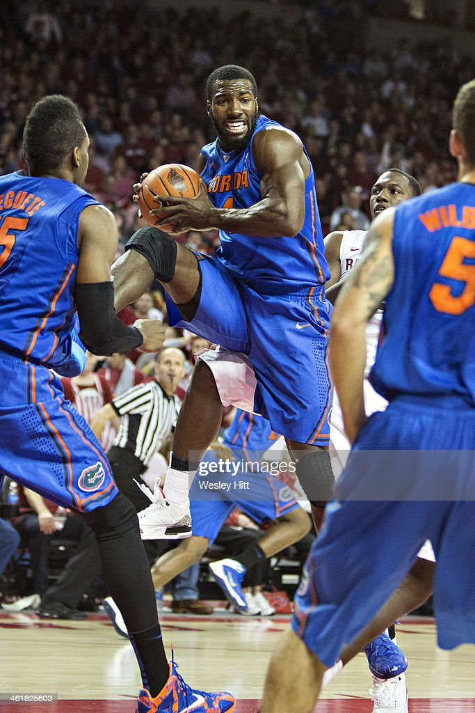 Patric Young #4 of the Florida Gators gets a rebound against the Arkansas Razorbacks at Bud Walton Arena on January 11, 2014 in Fayetteville, Arkansas. The Gators defeated the Razorbacks 84-82.