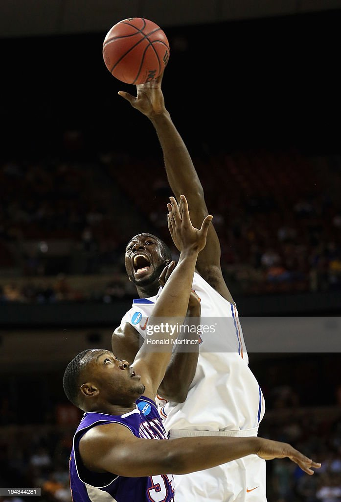 Patric Young #4 of the Florida Gators reaches for the ball over Gary Roberson #34 of the Northwestern State Demons during the second round of the 2013 NCAA Men's Basketball Tournament at The Frank Erwin Center on March 22, 2013 in Austin, Texas.