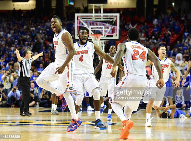 Patric Young Will Yeguete Casey Prather Dorian FinneySmith and Scottie Wilbekin of the Florida Gators celebrate as the horn blows to win the SEC...