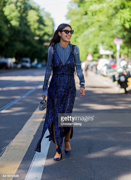Patrica Manfield wearing a blue dress outside Fendi during the Milan Men's Fashion Week Spring/Summer 2017 on June 20 2016 in Milan Italy