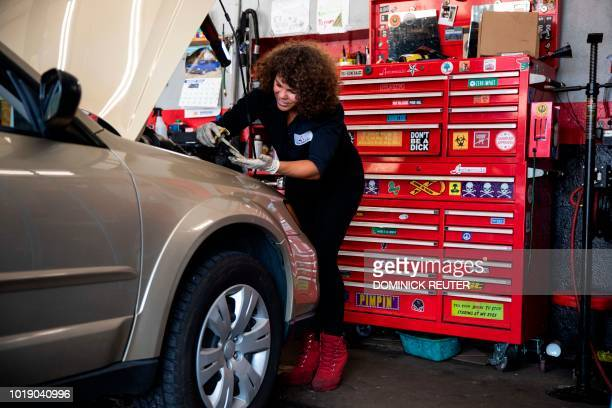 Patrice Banks founder and owner of the Girls Auto Clinic performs a service check at her garage in Upper Darby Pennsylvania on August 7 2018 On the...