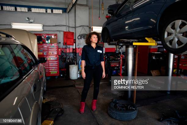 Patrice Banks founder and owner of the Girls Auto Clinic poses for a portrait at her garage in Upper Darby Pennsylvania on August 7 2018 On the...