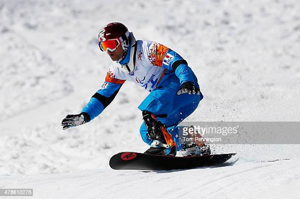 Patrice Barattero of France competes during the Men's Para Snowboard Cross Standing on day seven of the Sochi 2014 Paralympic Winter Games at Rosa...