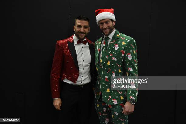 Patrice Bergeron and David Backes of the Boston Bruins wear festive holiday suits before the game against the New York Rangers at the TD Garden on...