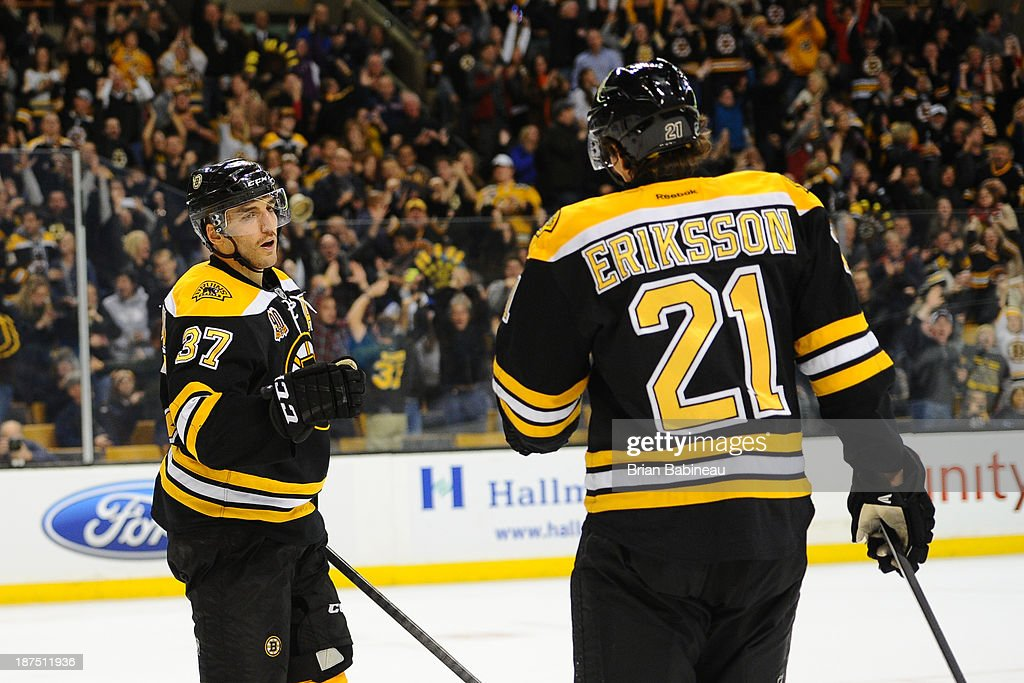 Patrice Bergeron #37 and Loui Eriksson #21 of the Boston Bruins celebrate a goal against the Toronto Maple Leafs at the TD Garden on November 9, 2013 in Boston, Massachusetts.