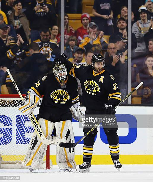 Patrice Bergeron and Niklas Svedberg of the Boston Bruins celebrate their win over the Detroit Red Wings at TD Garden on March 8 2015 in Boston...