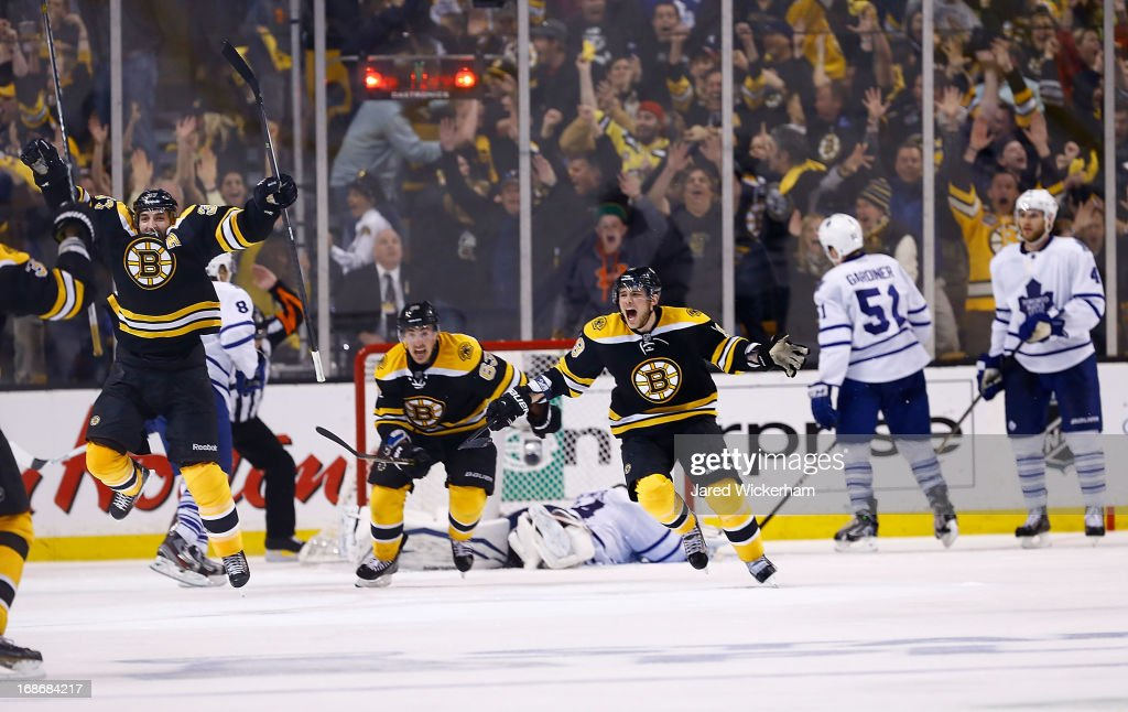 Patrice Bergeron #37 and Tyler Seguin #19 of the Boston Bruins celebrate following Bergeron's game-winning overtime goal against the Toronto Maple Leafs in Game Seven of the Eastern Conference Quarterfinals during the 2013 NHL Stanley Cup Playoffs on May 13, 2013 at TD Garden in Boston, Massachusetts.