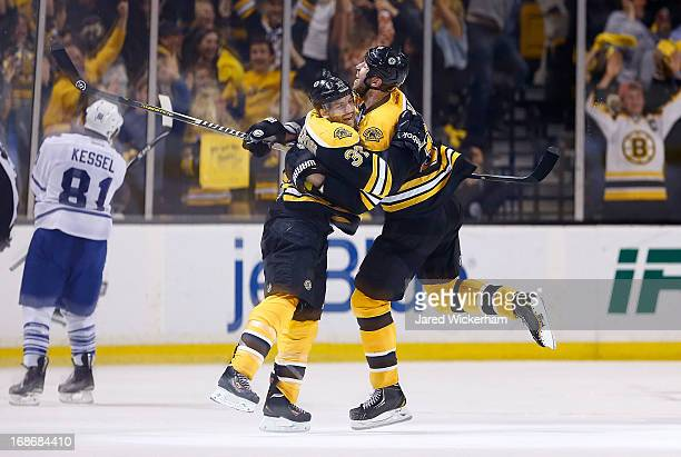 Patrice Bergeron and Zdeno Chara of the Boston Bruins celebrate following Bergeron's gamewinning overtime goal against the Toronto Maple Leafs in...