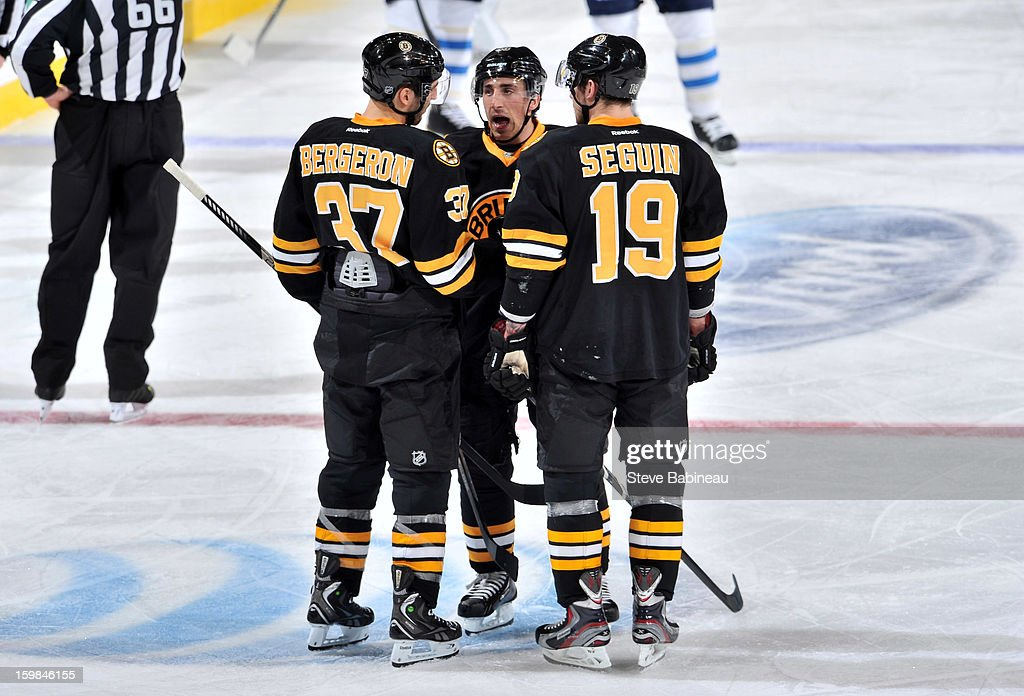 Patrice Bergeron #37, Brad Marchand #63 and Tyler Seguin #19 of the Boston Bruins talk during a time out against the Winnipeg Jets at the TD Garden on January 21, 2013 in Boston, Massachusetts.