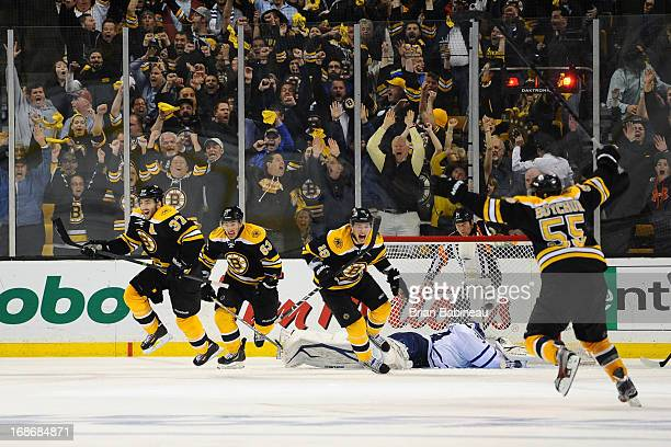 Patrice Bergeron Brad Marchand Tyler Seguin and Johnny Boychuk of the Boston Bruins react to winning in overtime against the Toronto Maple Leafs in...