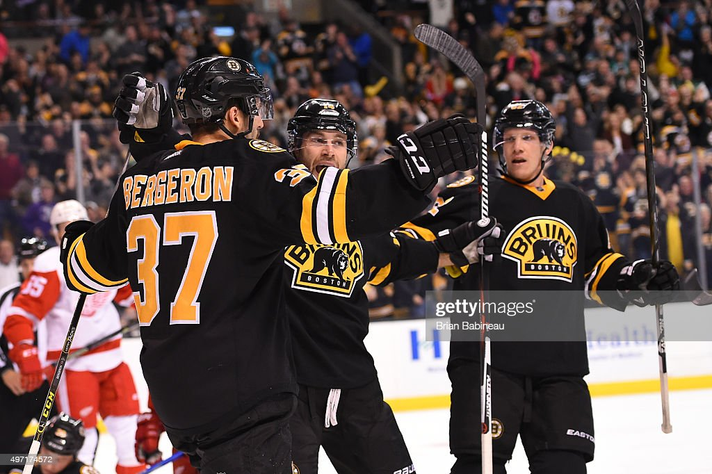 Patrice Bergeron #37, Brett Connolly and Joonas Kemppainen #41 of the Boston Bruins celebrate a goal against the Detroit Red Wings at the TD Garden on November 14, 2015 in Boston, Massachusetts.