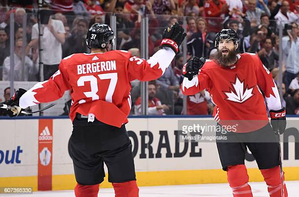 Patrice Bergeron celebrates with Brent Burns of Team Canada after a first period goal against Team Czech Republice during the World Cup of Hockey...