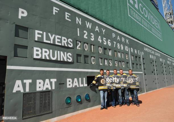 Patrice Bergeron, David Krejic, Aaron Ward, Shawn Thornton and Marco Sturm of the Boston Bruins pose in front of the Green Monster after a press...