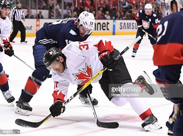 Patrice Bergeron of Team Canada battles for the puck with Ryan Kesler of Team USA during the World Cup of Hockey 2016 at Air Canada Centre on...