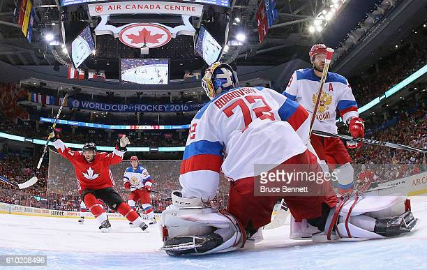 Patrice Bergeron of Team Canada celebrates a third period goal by Brad Marchand against Sergei Bobrovsky of Team Russia at the semifinal game during...