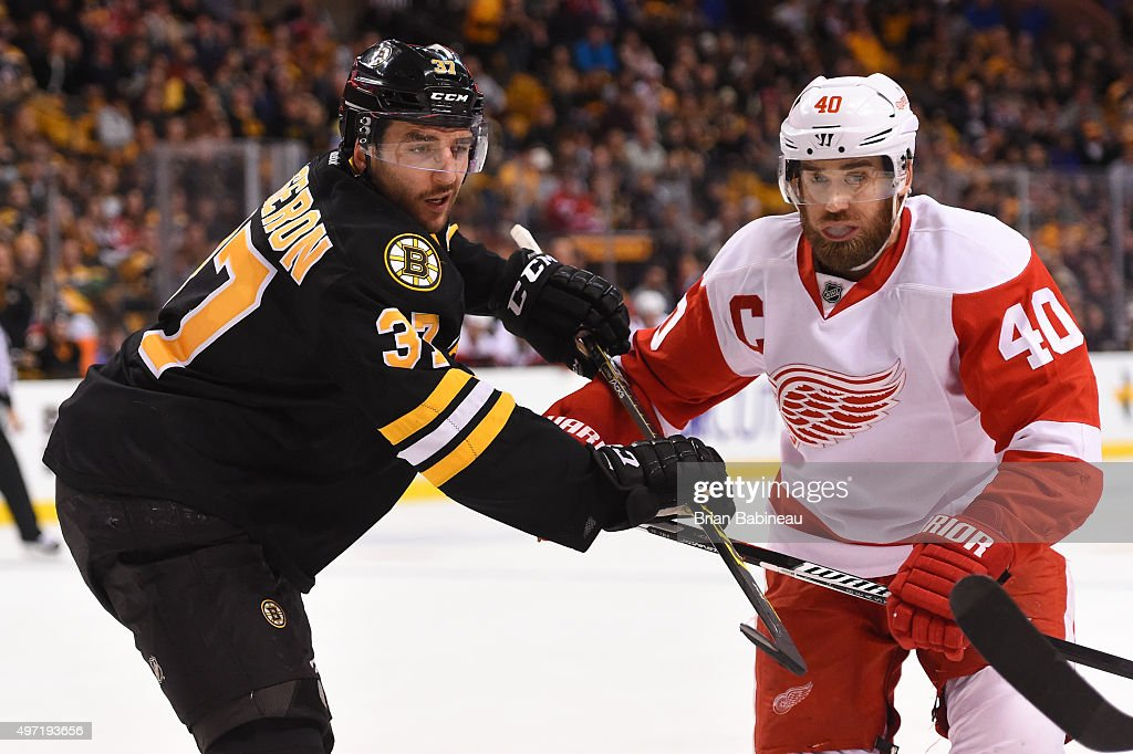 Patrice Bergeron #37 of the Boston Bruins against Henrik Zetterberg #40 of the Detroit Red Wings at the TD Garden on November 14, 2015 in Boston, Massachusetts.