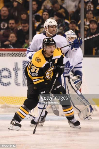 Patrice Bergeron of the Boston Bruins against Nazem Kadri of the Toronto Maple Leafs at the TD Garden on November 11 2017 in Boston Massachusetts