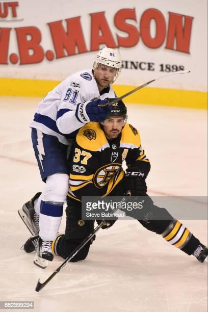 Patrice Bergeron of the Boston Bruins against Steven Stamkos of the Tampa Bay Lightning at the TD Garden on November 29 2017 in Boston Massachusetts