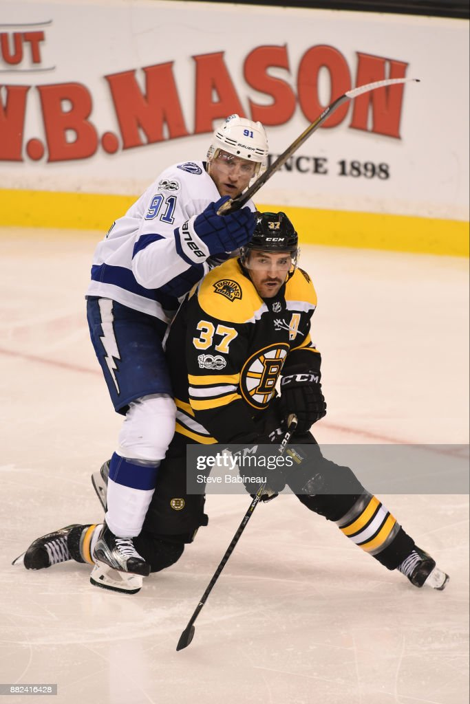 Patrice Bergeron #37 of the Boston Bruins against Steven Stamkos #91 of the Tampa Bay Lightning at the TD Garden on November 29, 2017 in Boston, Massachusetts.