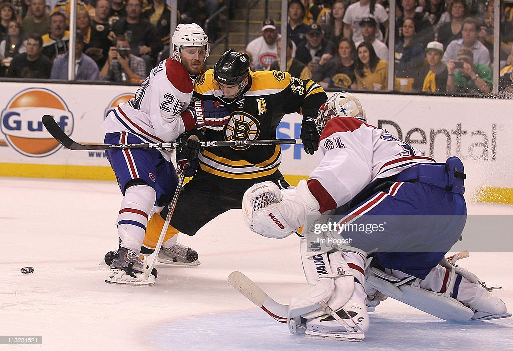 Patrice Bergeron #37 of the Boston Bruins battles James Wisniewski #20 of the Montreal Canadiens in front of the goal in Game Seven of the Eastern Conference Quarterfinals during the 2011 NHL Stanley Cup Playoffs at TD Garden on April 27, 2011 in Boston, Massachusetts.