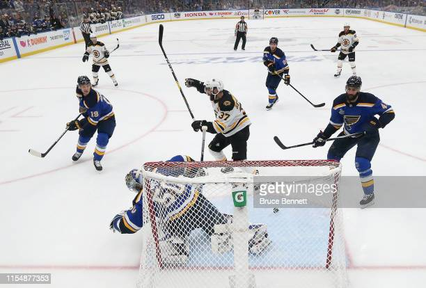 Patrice Bergeron of the Boston Bruins celebrates a first period goal byt teammate Brad Marchand past Jordan Binnington of the St Louis Bluesin Game...