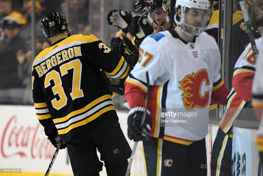 Patrice Bergeron #37 of the Boston Bruins celebrates a goal against the Calgary Flames at the TD Garden on February 13, 2018 in Boston, Massachusetts.