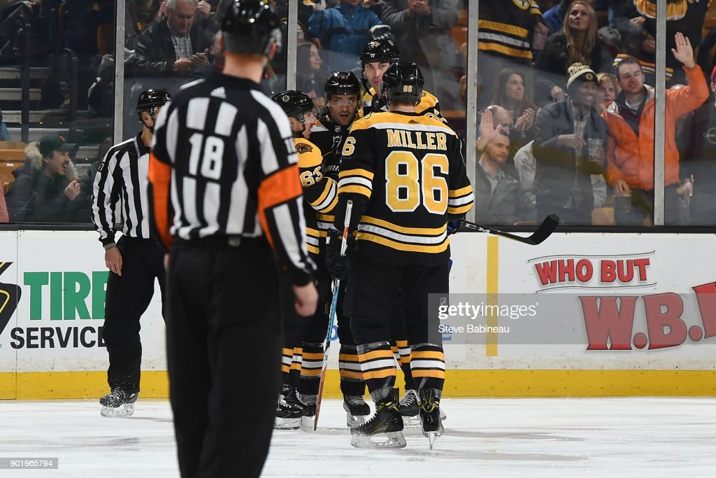 Patrice Bergeron #37 of the Boston Bruins celebrates a goal in the first period against the Carolina Hurricanes at the TD Garden on January 6, 2018 in Boston, Massachusetts.