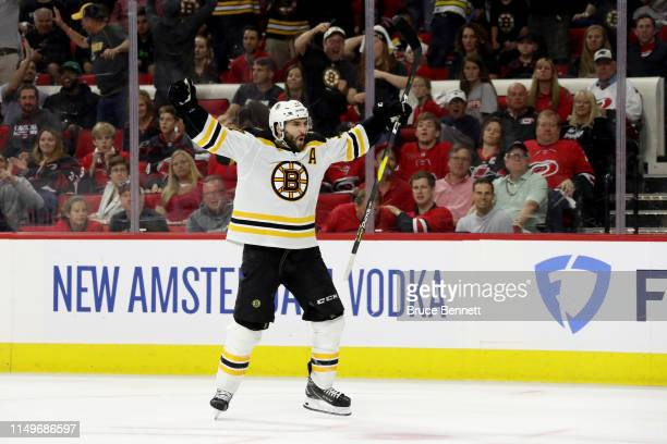 Patrice Bergeron of the Boston Bruins celebrates after scoring a goal on Curtis McElhinney of the Carolina Hurricanes during the third period in Game...