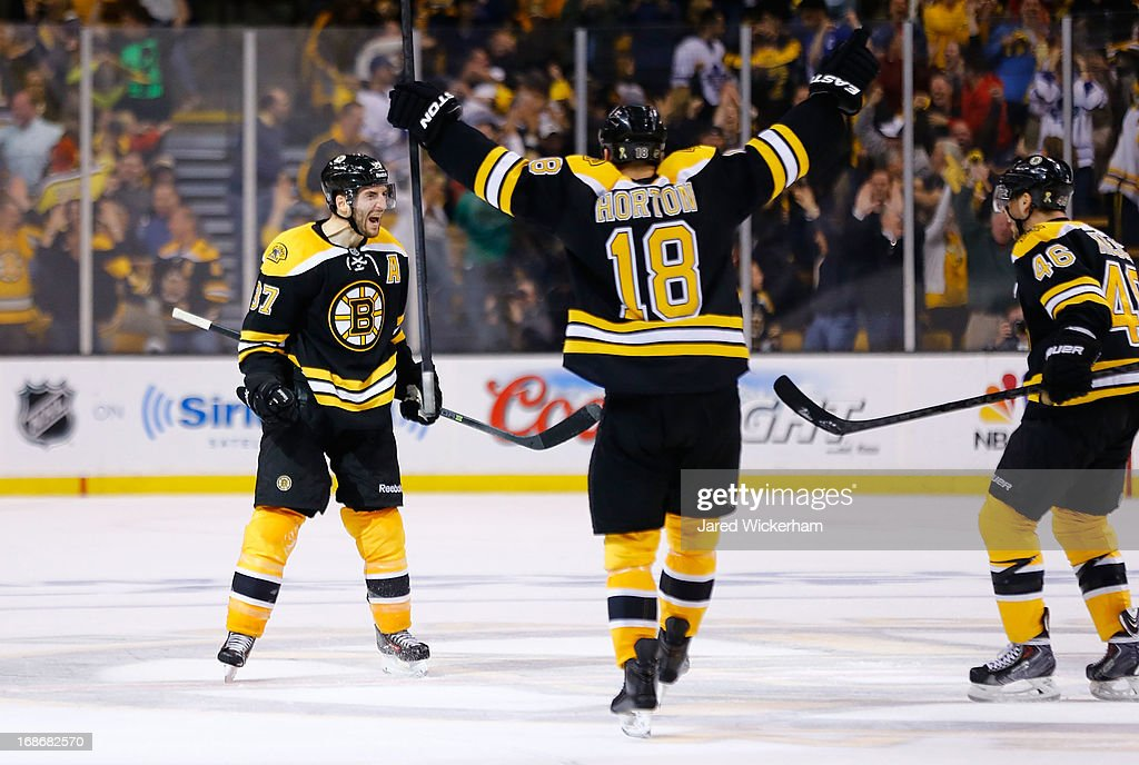 Patrice Bergeron #37 of the Boston Bruins celebrates after scoring the game-tying goal in the third period against the Toronto Maple Leafs in Game Seven of the Eastern Conference Quarterfinals during the 2013 NHL Stanley Cup Playoffs on May 13, 2013 at TD Garden in Boston, Massachusetts.